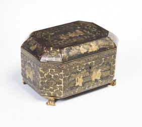 A Black Lacquer And Gilt Chinoiserie Tea Caddy, 19th
