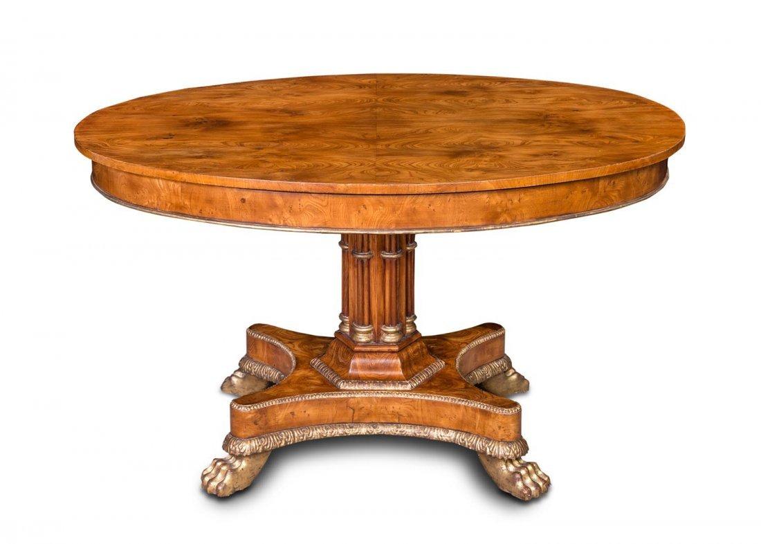 A Karl Johan inlaid elm and parcel gilt centre table,