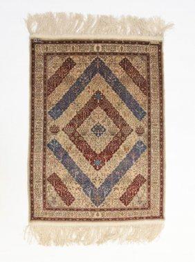 A Turkish Hereke Pattern Silk Rug, 20th Century