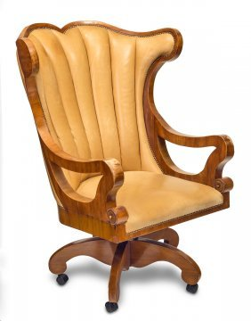 A Continental Leather Upholstered fruitwood Swivel