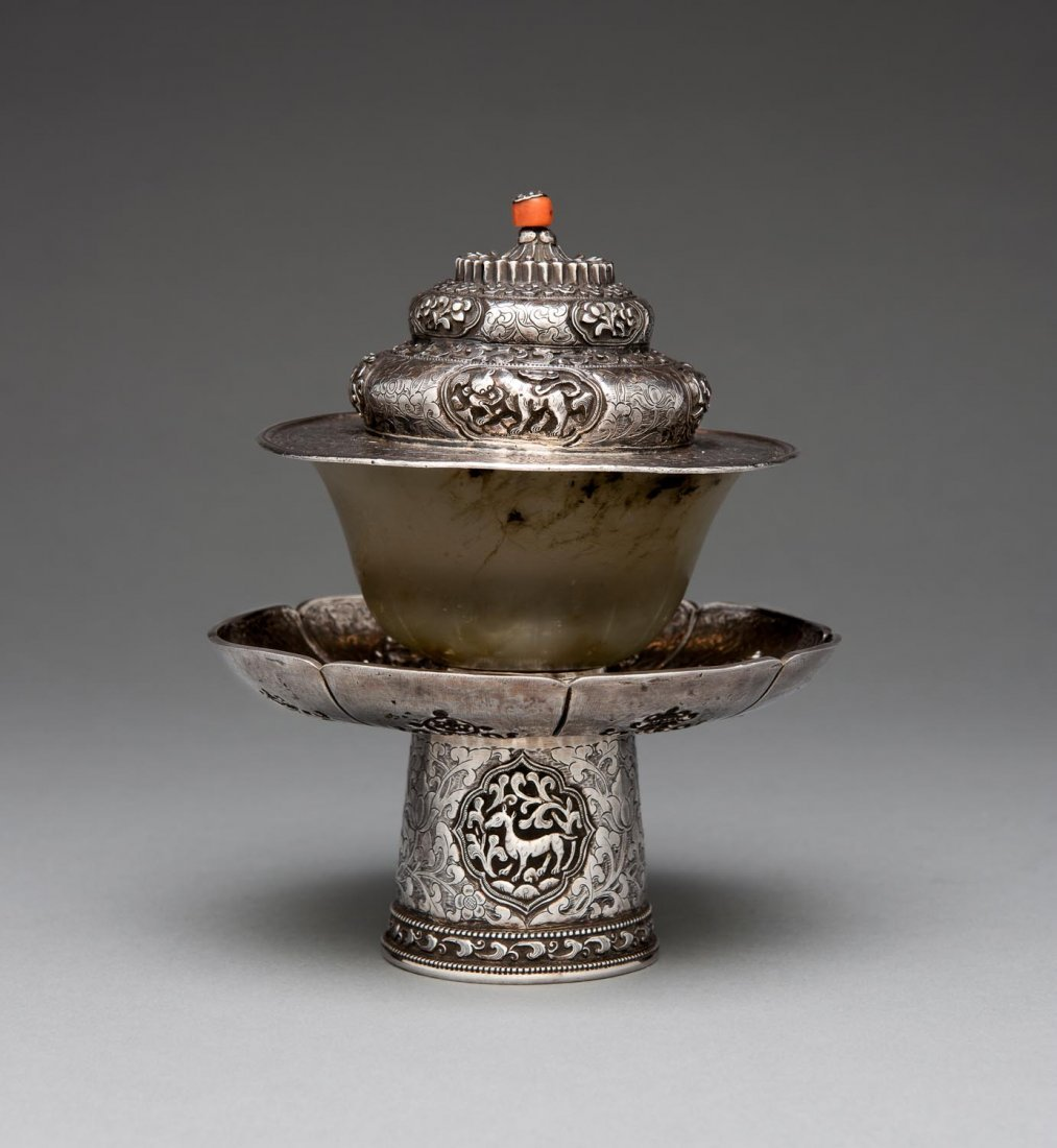 A Tibetan agate teacup and silver cup stand and cover,