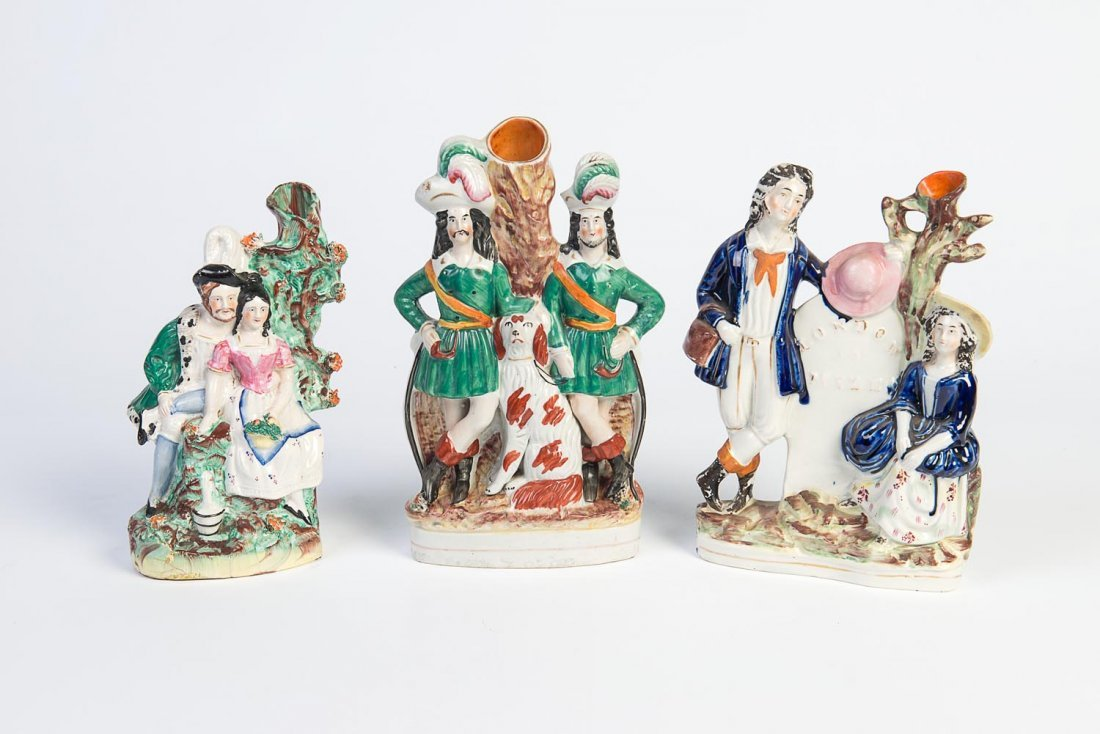 Three Staffordshire portrait figure spill vases, 19th