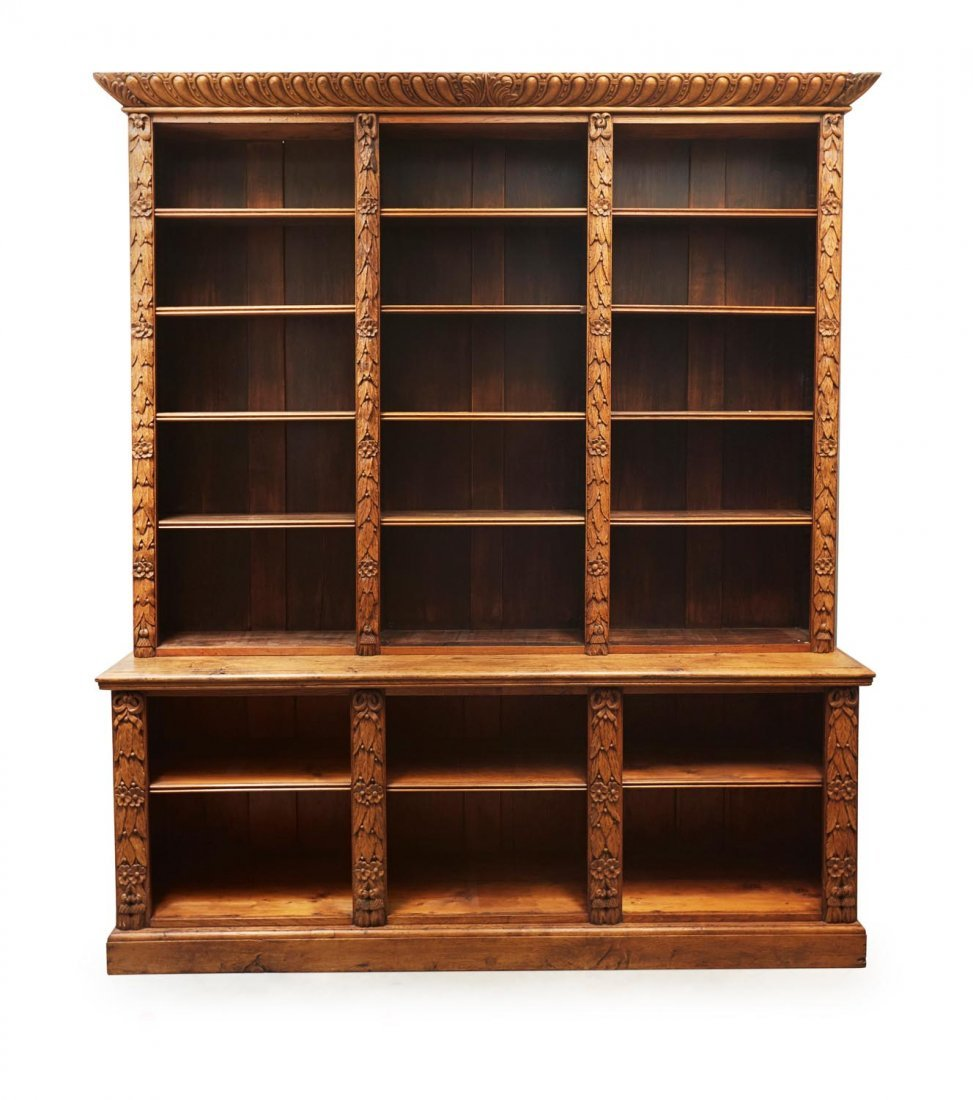 A Victorian carved oak open bookcase, 19th century