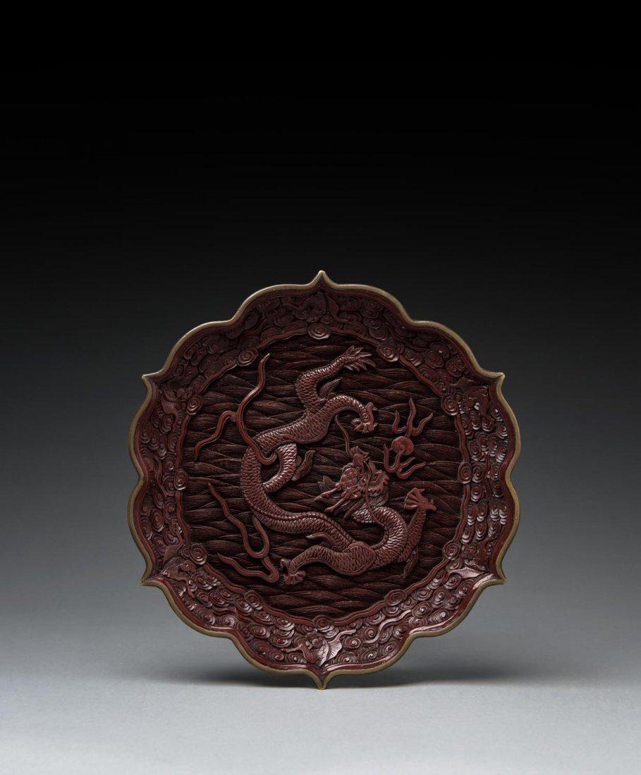 A Chinese cinnabar lacquer dish, Qianlong mark, late