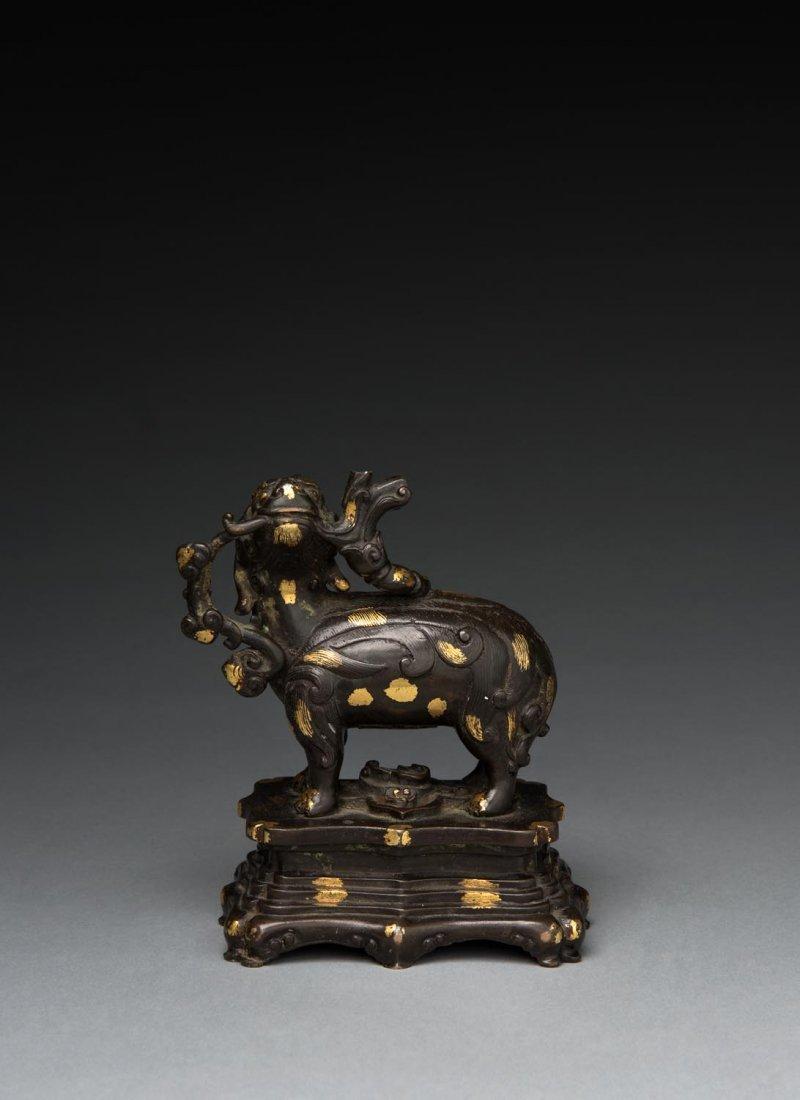 """An unusual gold splashed bronze """"Qilin"""", Qing dynasty"""