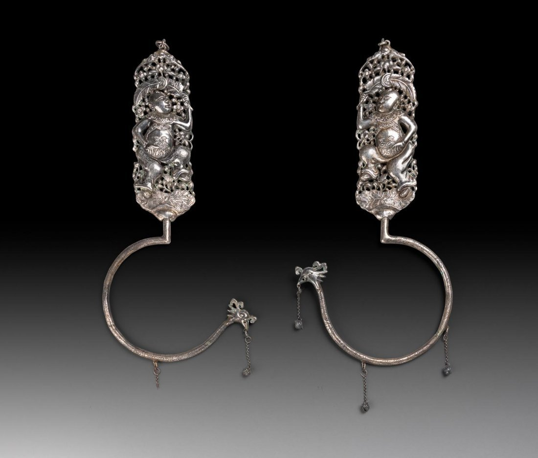 AAn unusual pair of Chinese silver hooks, late Qing