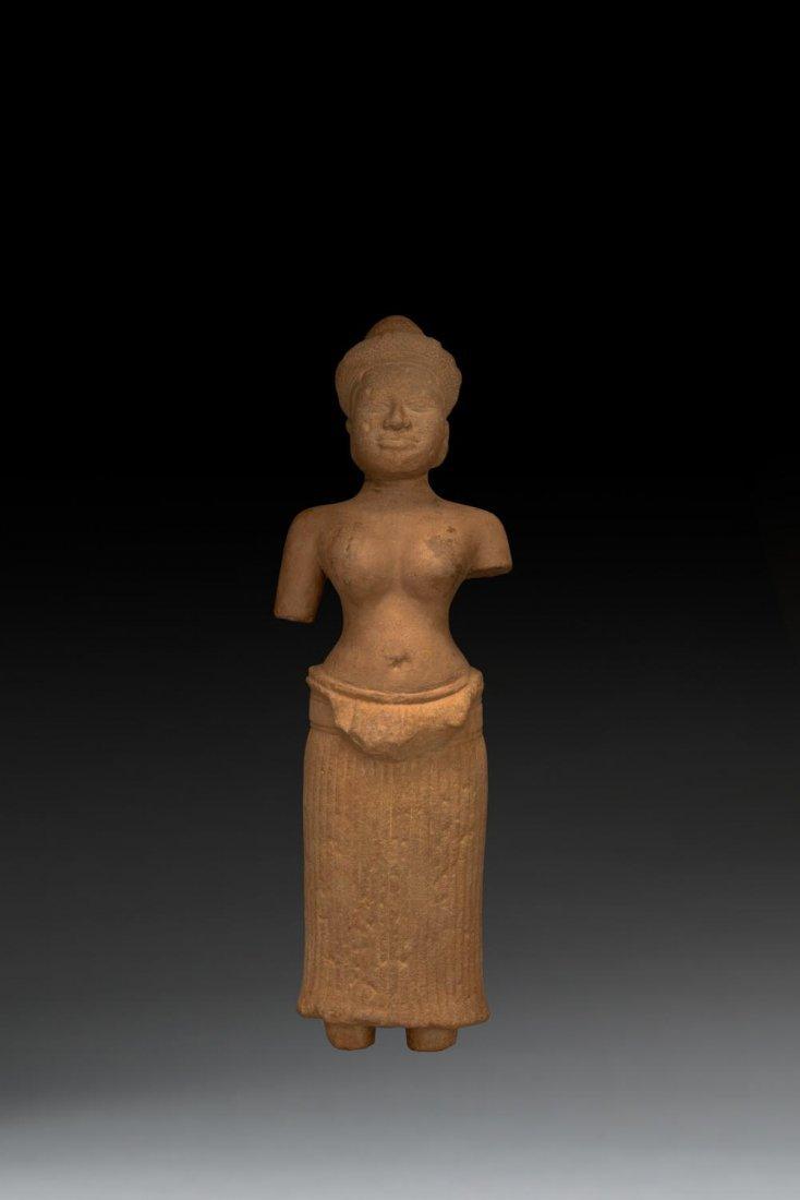 A Khmer stone carving of a female Hindu deity,