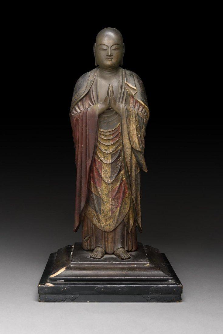 A JAPANESE POLYCHROME WOOD FIGURE OF ANANDA,