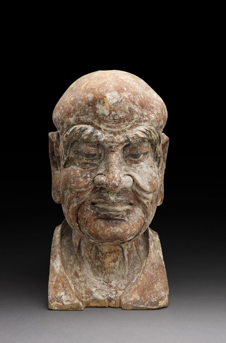 A LARGE CHINESE WOODEN HEAD OF A LUOHAN, JIN/YUAN