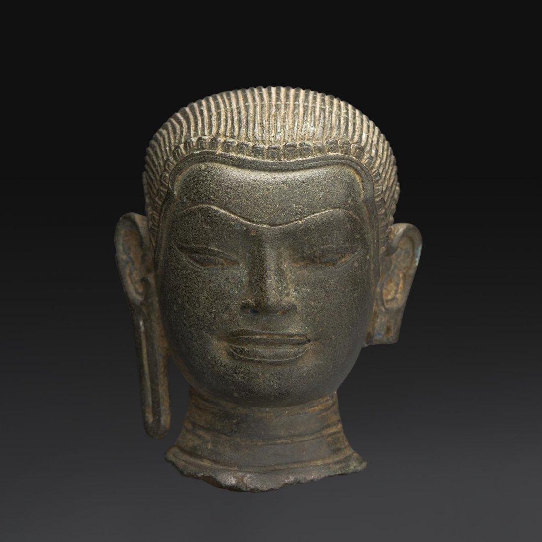 A SMALL KHMER BRONZE HEAD OF BUDDHA, ANGKOR WAT, BAYON