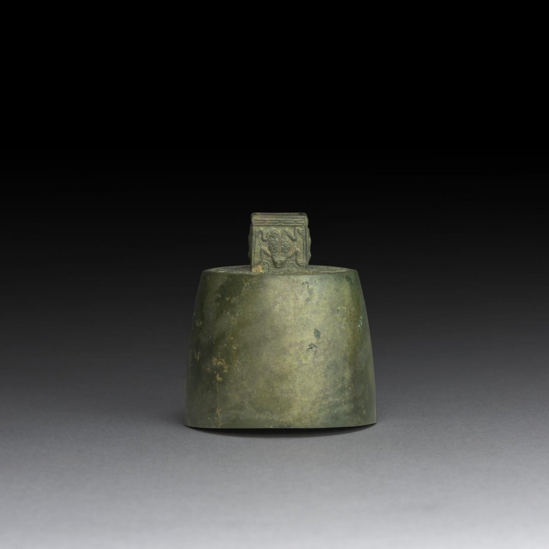 A VERY RARE ARCHAIC TINY BRONZE BELL, PROBABLY SPRING