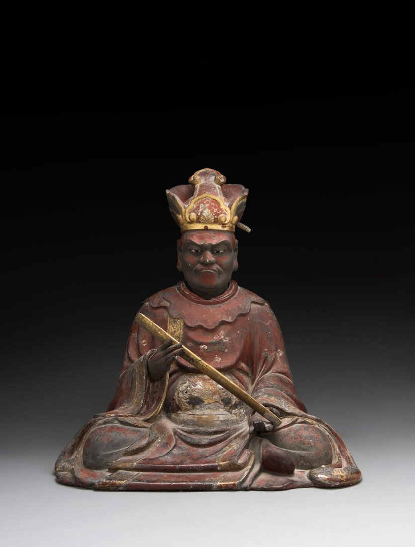 A JAPANESE RED AND GOLD LACQUERED WOODEN FIGURE,  EARLY