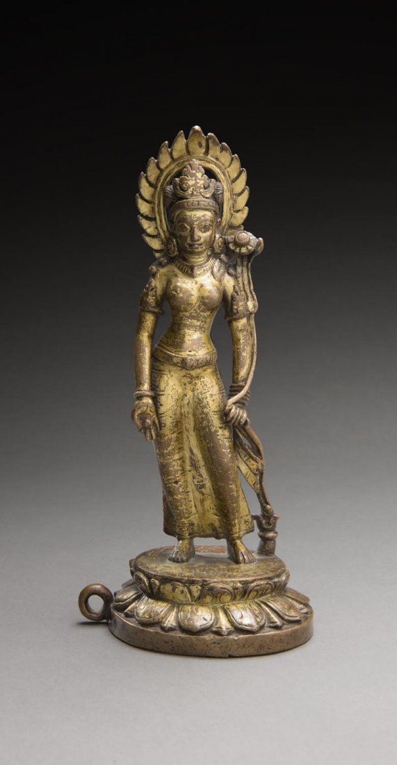 A VERY FINE AND RARE NEPALESE BRONZE PARCEL-GILT FIGURE