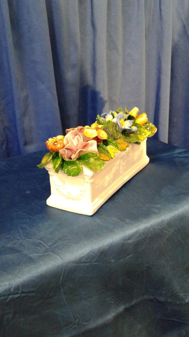 Pair of  rectangle bases with flowers