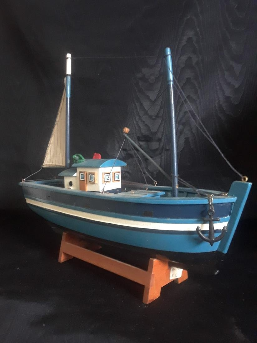 fishing boat with sail