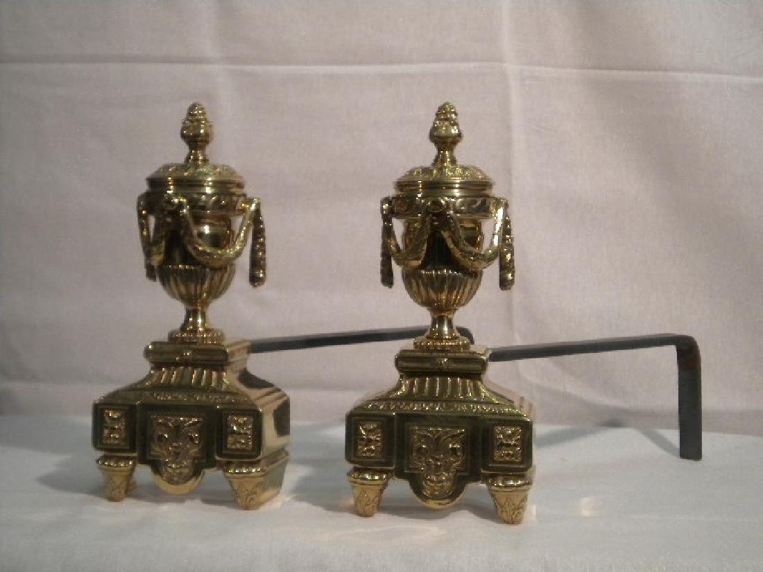 Pair of gilt brass andirons