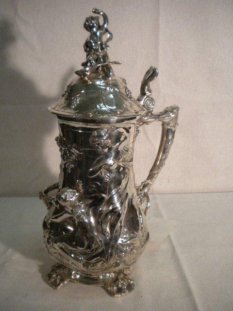 12: Silver plated tankard