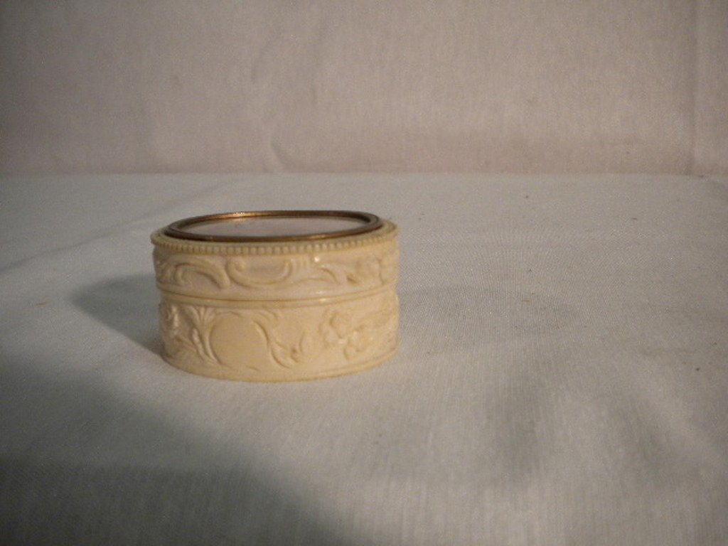 Small ivory box with miniature
