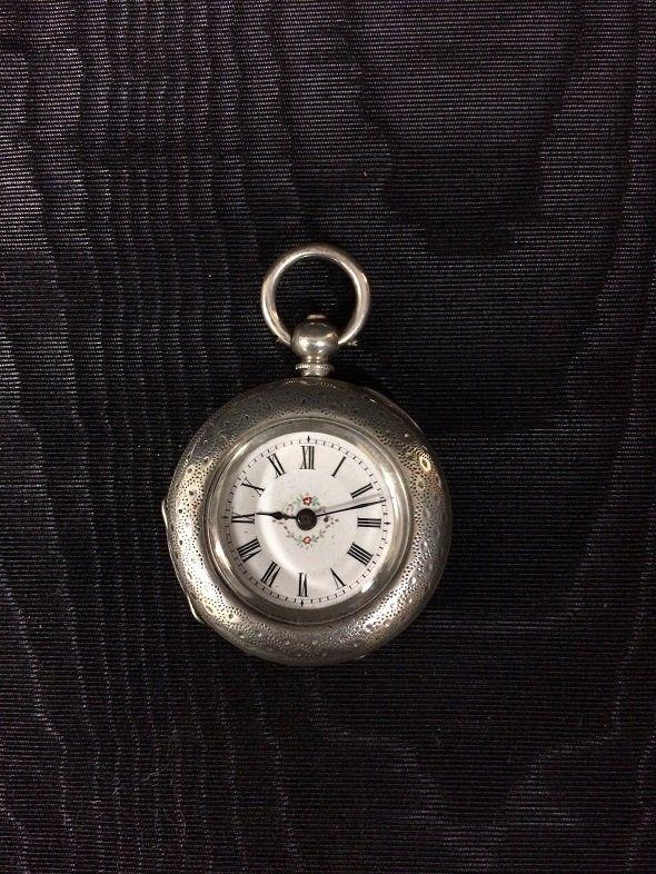 Silver pocket clock