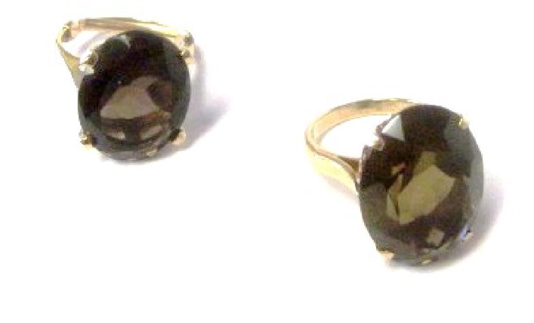 Two smokey topaz rings