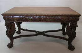 R.J. HORNER CARVED MAHOGANY LIBRARY TABLE