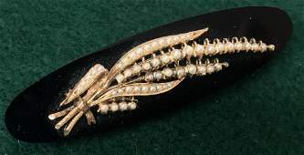 VICTORIAN JET BROOCH MOUNTED WITH 14K GOLD