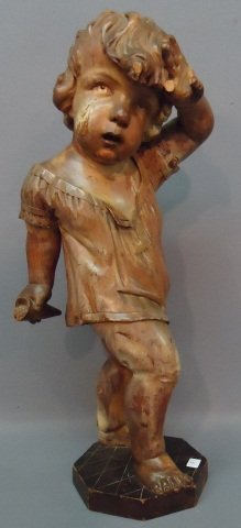 7: CARVED WOODEN FIGURE OF A YOUNG CHILD