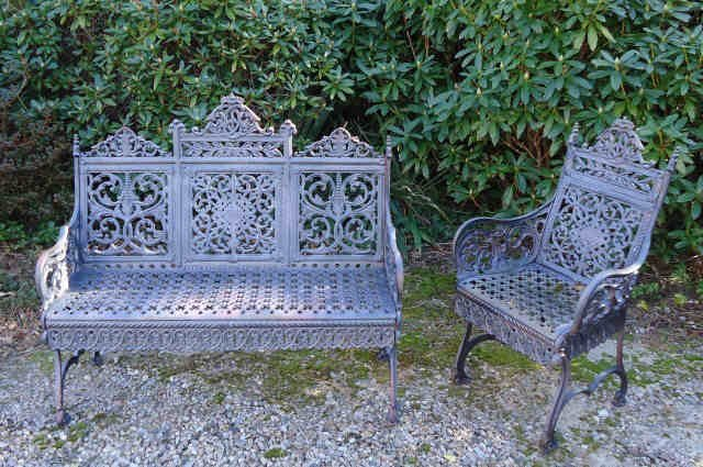 31: PETER TIMMES & SON CAST IRON BENCH AND ARM CHAIR