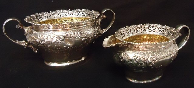 40: STERLING SILVER REPOUSSE CREAMER AND SUGAR BOWL