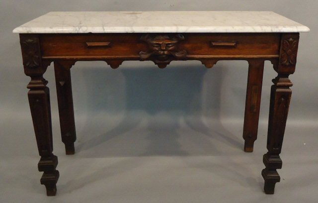 47: ENGLISH OAK LIBRARY TABLE WITH LION'S HEAD CARVING