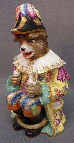 73: PORCELAIN FIGURINE OF A CHARACTER LION