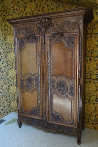 133: ORNATELY CARVED OAK ARMOIRE
