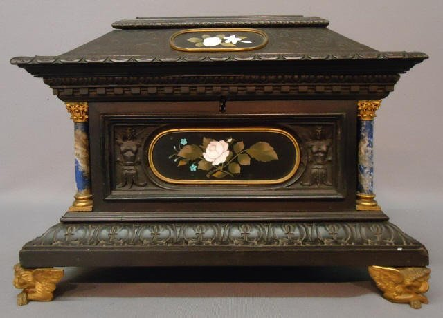 168: ITALIAN CARVED AND EBONIZED JEWELRY CABINET