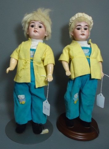 7: PAIR OF TWIN BISQUE SOCKET HEAD DOLLS