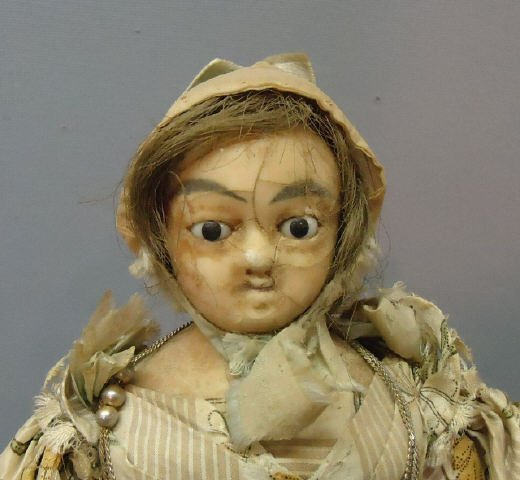 11: WAX HEAD DOLL WITH INSET EYES