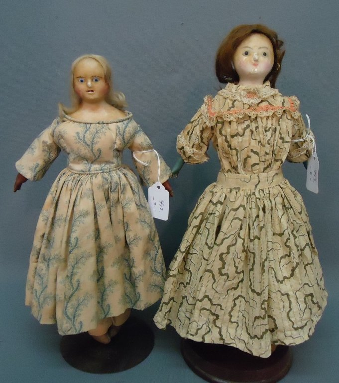 12: TWO EARLY WAX HEAD DOLLS WITH INSET GLASS EYES