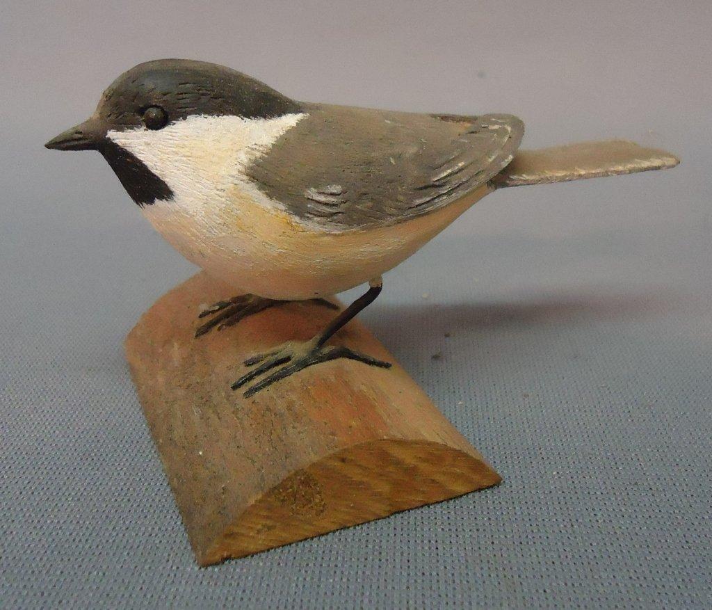22: BIRD CARVING OF A CHICKADEE SIGNED E.F.