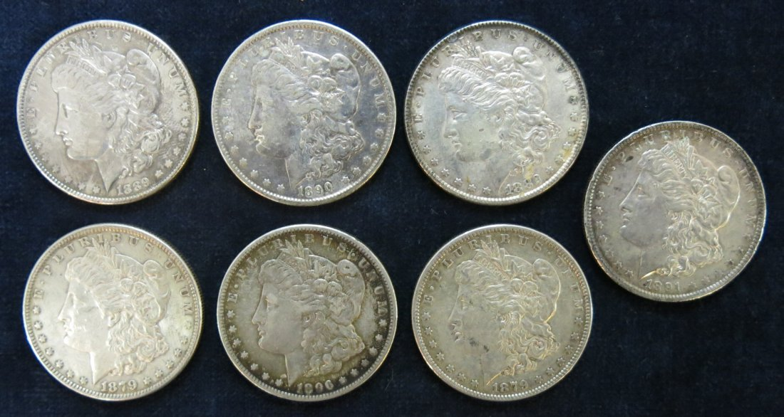 LOT OF 7 SILVER DOLLARS