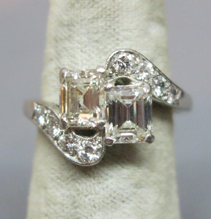 PLATINUM LADIES RING W/ TWO EMERALD CUT DIAMONDS