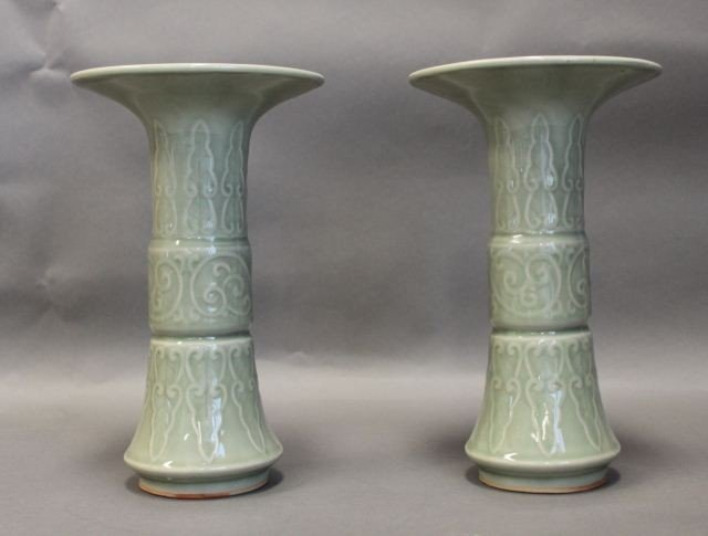 17: A PAIR OF CHINESE CELADON TRUMPET VASES