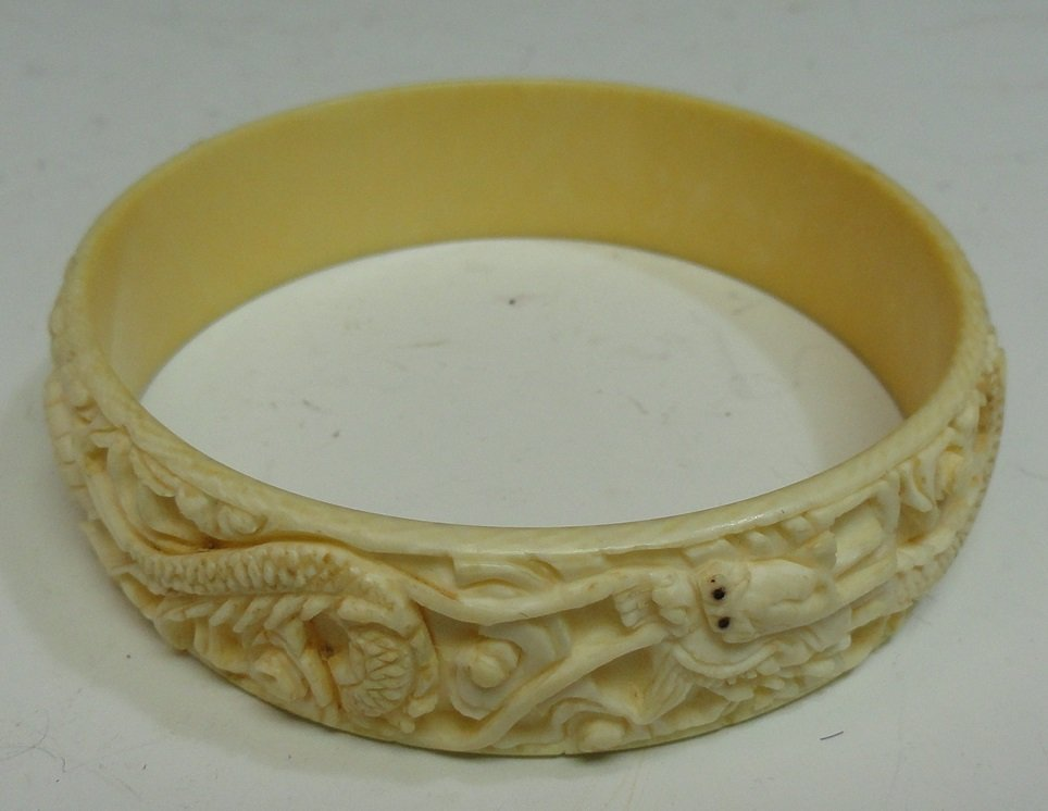 A 19th Century Chinese Export Ivory Bangle.