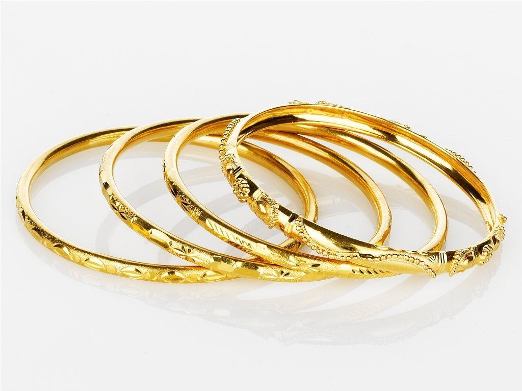 23: Four Gold Bangles