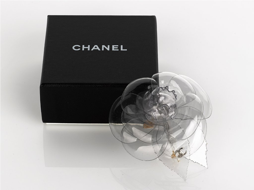 15: CHANEL, Clear Plastic Camellia Pin Brooch