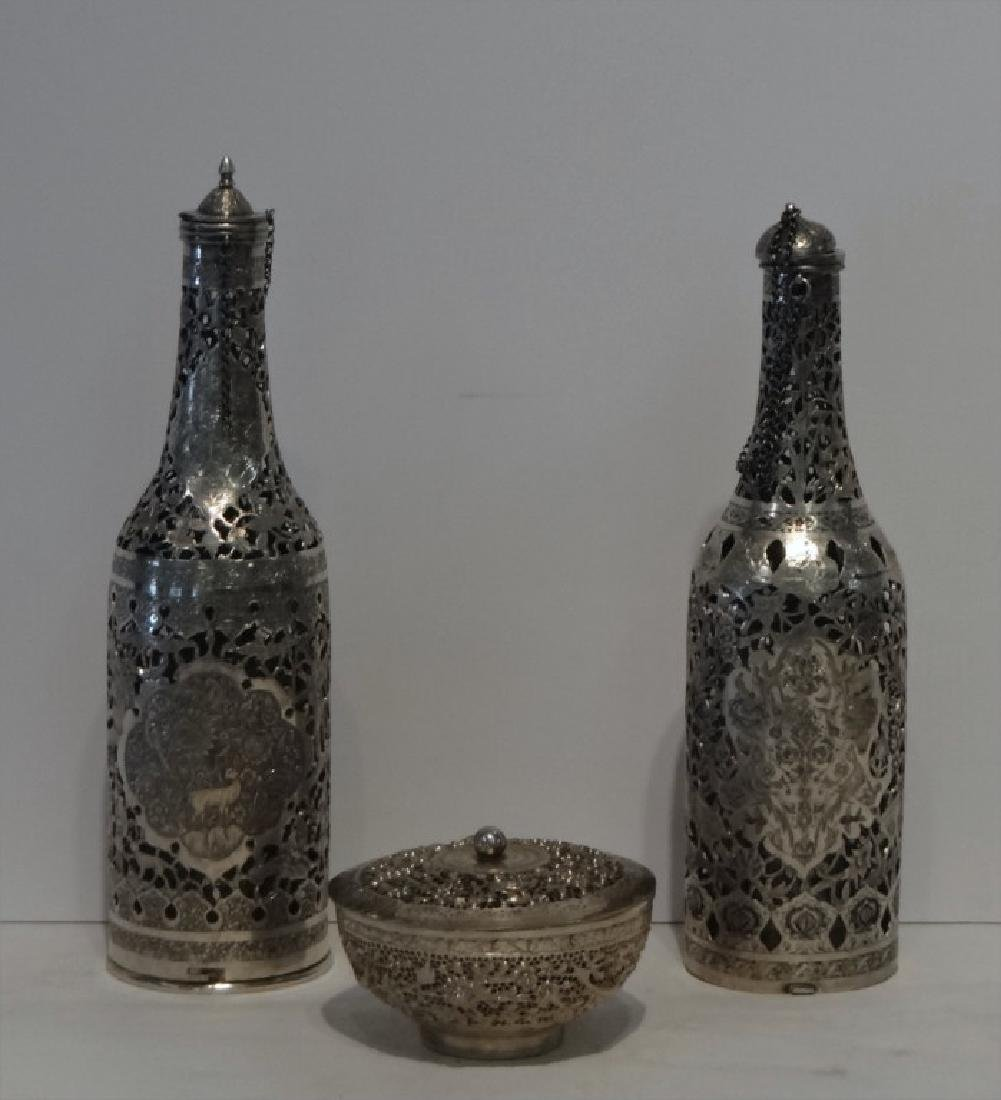 2 PIERCED WORK PERSIAN SILVER COVERED BOTTLES