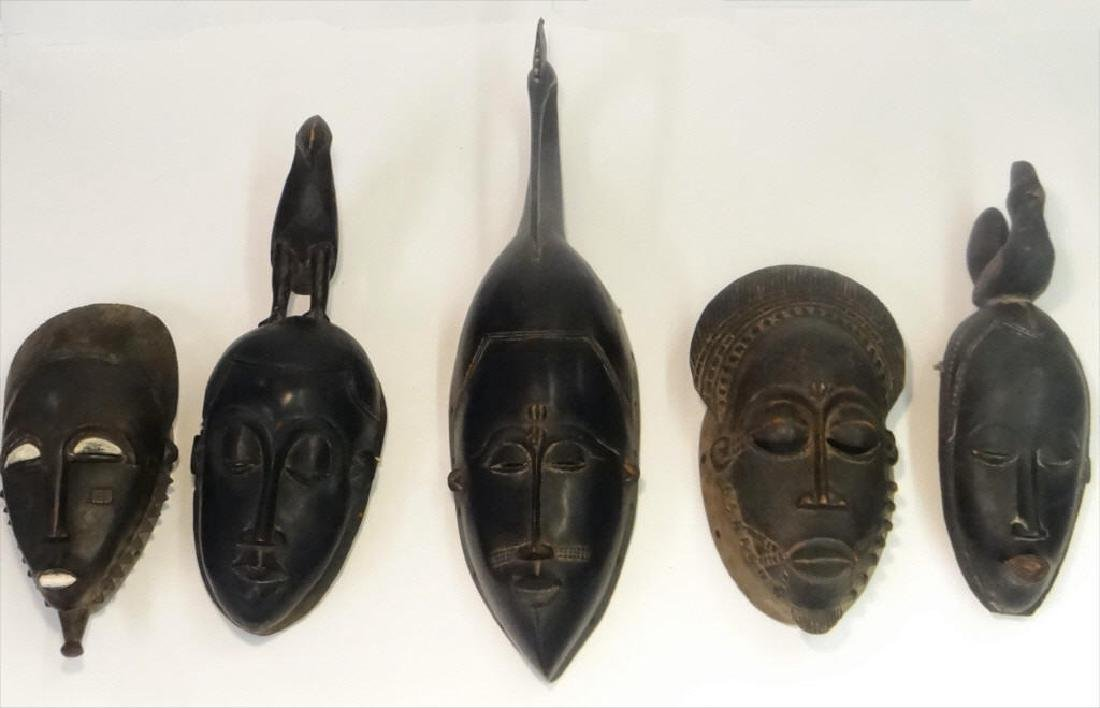 GROUP OF GOLD COAST AFRICAN MASKES , 5