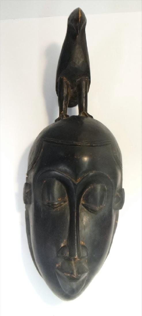 GROUP OF GOLD COAST AFRICAN MASKES , 5 - 4