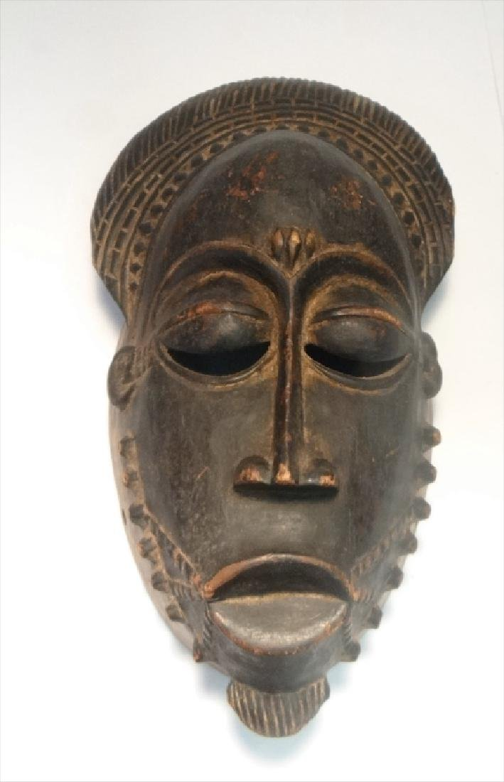 GROUP OF GOLD COAST AFRICAN MASKES , 5 - 7