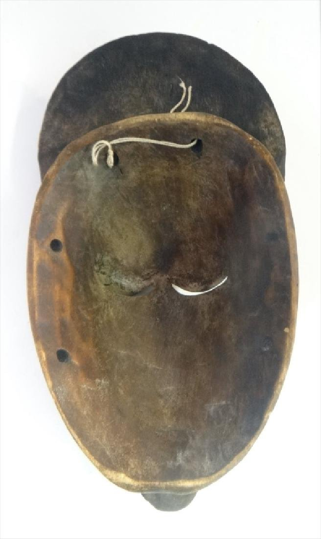 GROUP OF GOLD COAST AFRICAN MASKES , 5 - 8