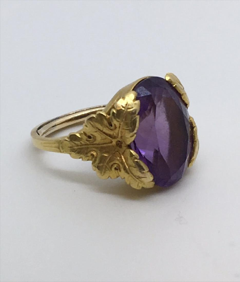 OVAL AMETHYST SET IN 18KT YELLOW GOLD RING