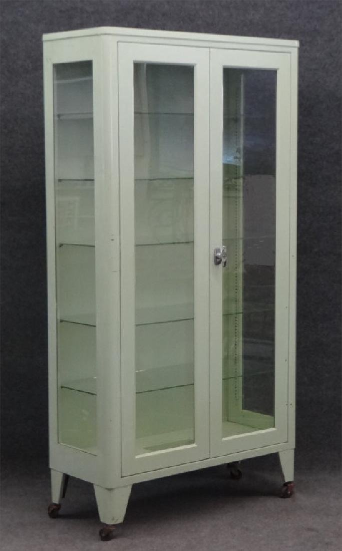 2 DR METAL & GLASS CABINET BY UNITED METAL FABRI.